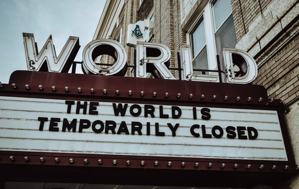 the world is temporarily closed signage