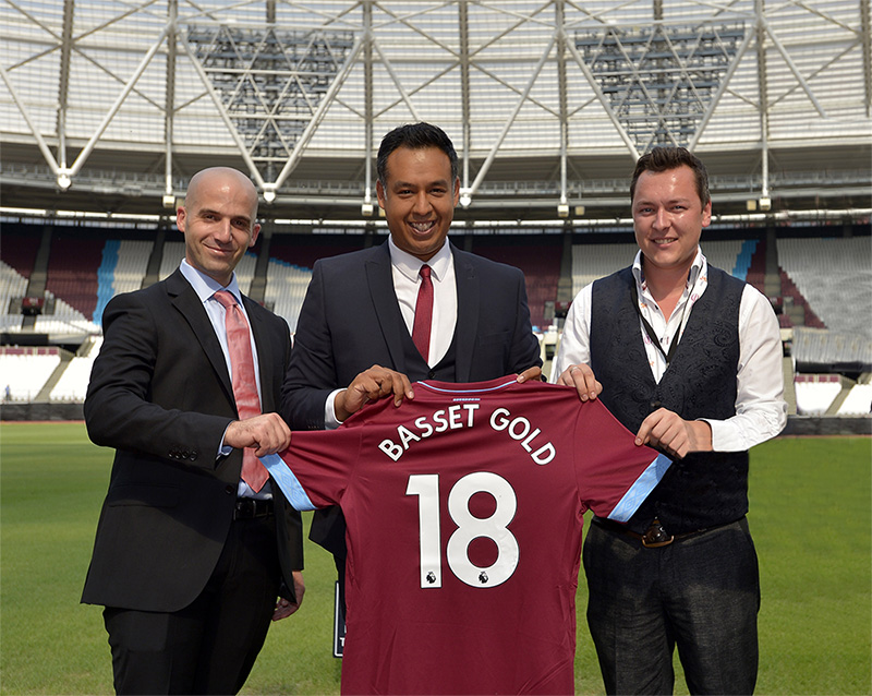 Basset & Gold directors Guy Hadas (L) and Daniel Smith (R) pose with West Ham's Karim Virani
