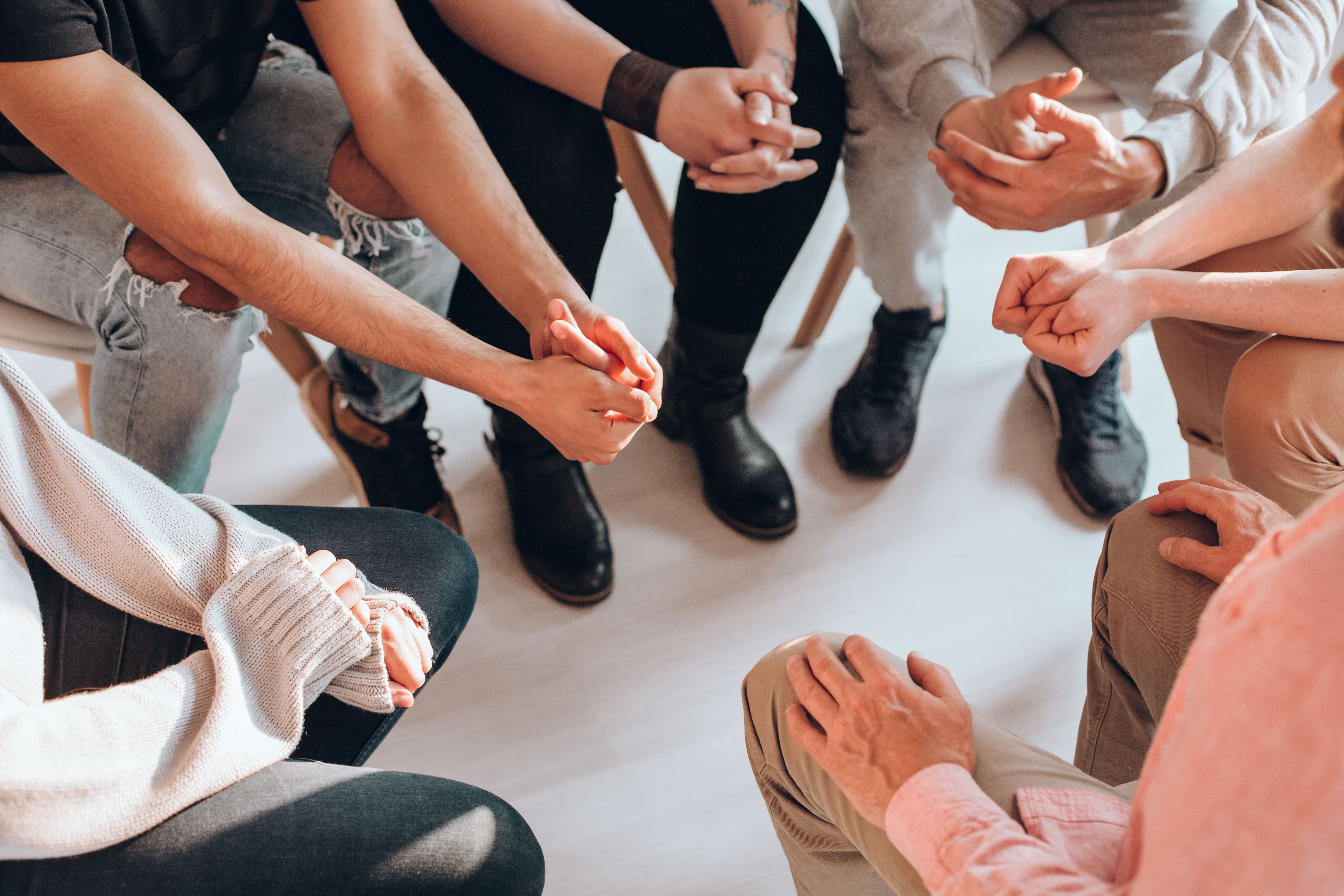 Support Group with Hands Together