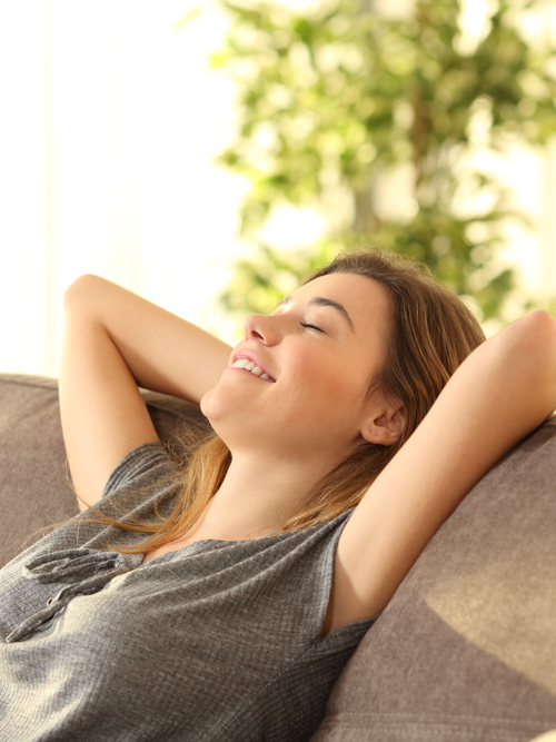 woman in her home enjoying fresh air