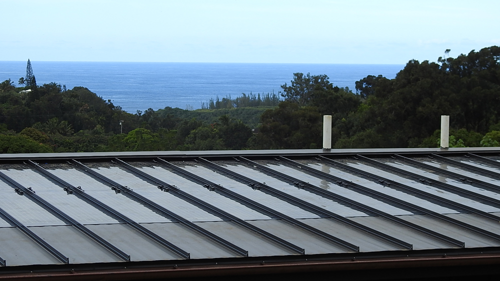 Sunflare's latest thin-film solar module fits between seams of metal roof