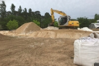 GeoPro being mixed with the sand on site