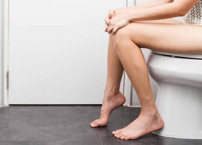 Young_women_in_bathroom_on_toilet