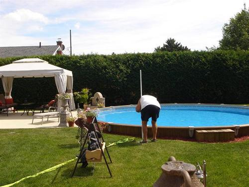 terrible real estate pictures man cleaning pool