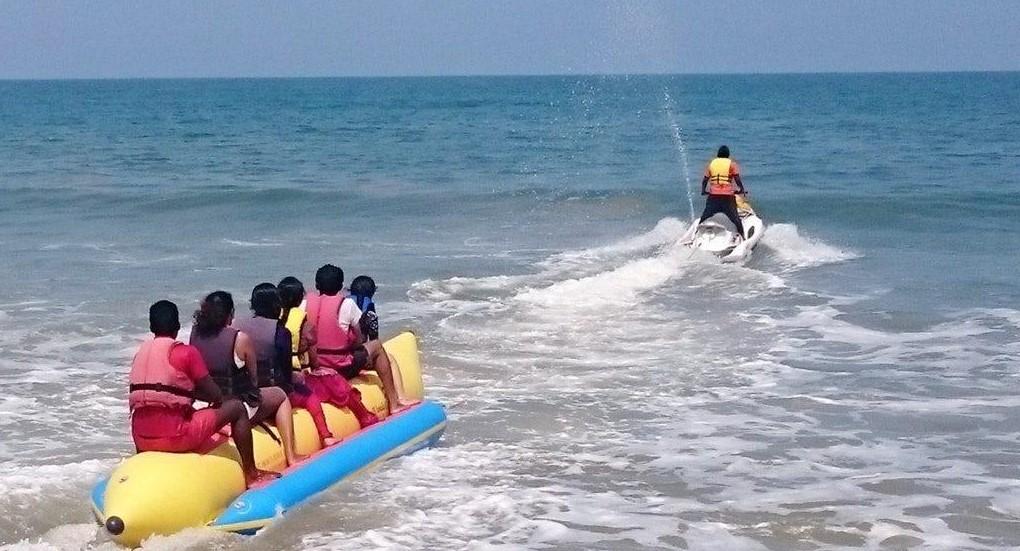 Family Enjoying water sports banana ride in Andaman