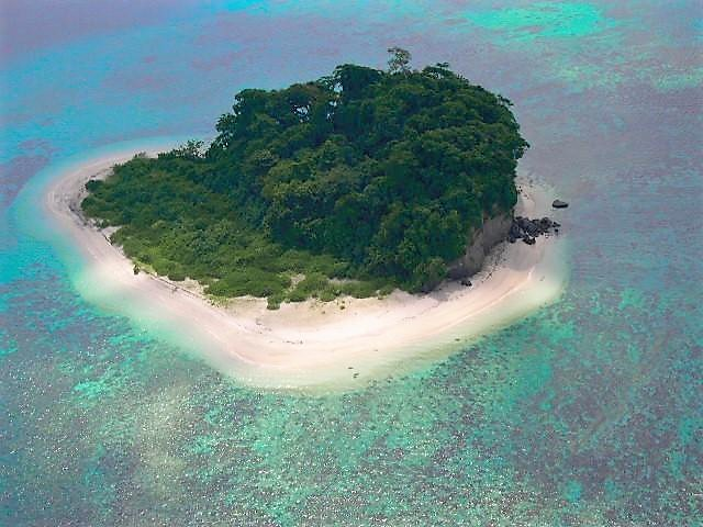 Aerial view of Jolly Buoy Island surrounded with shallow water and visible corals
