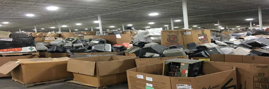 Large stockpile of old CRT monitors in boxes
