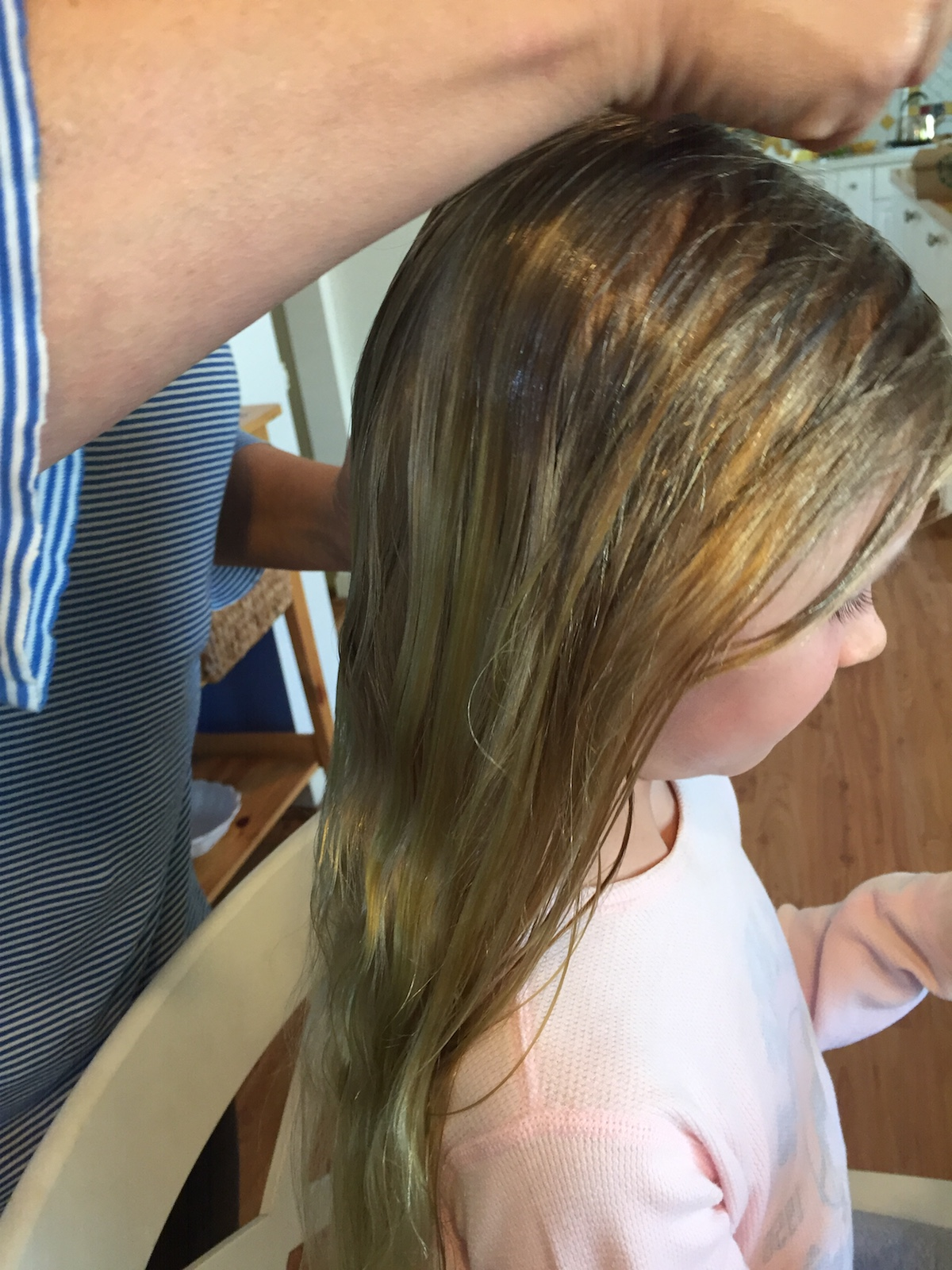 young girl receiving lice treatment southern california