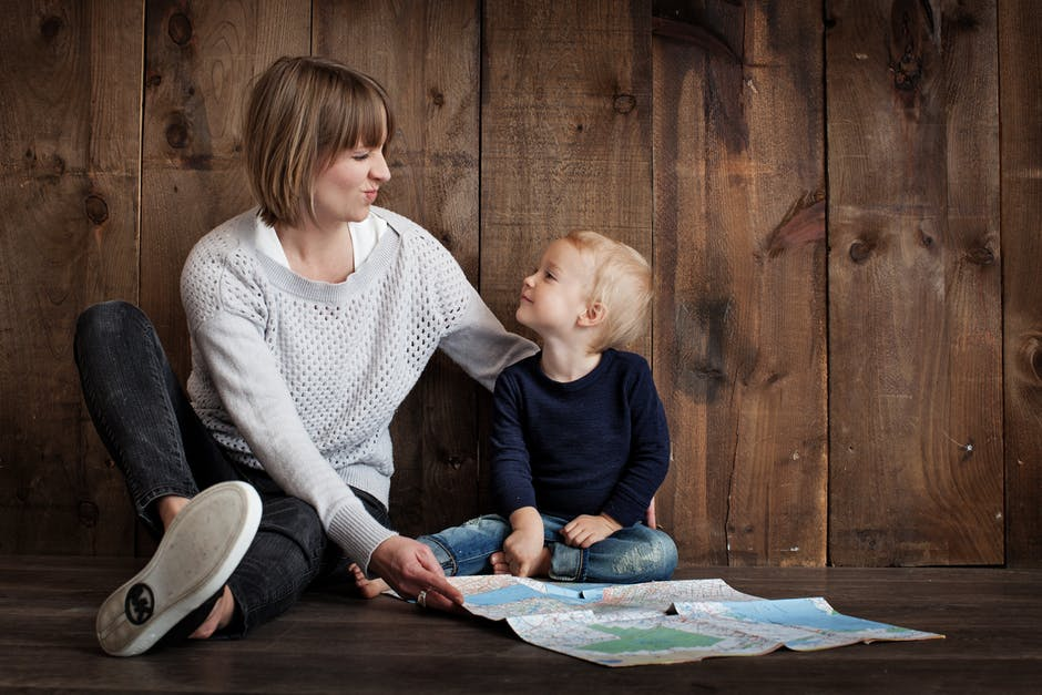 child with woman holding map