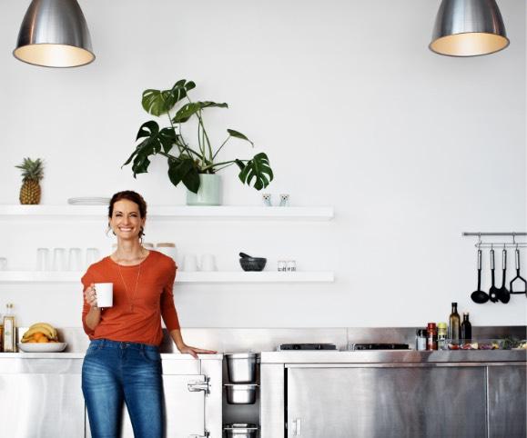 A woman having coffee in her beautiful customized modern home