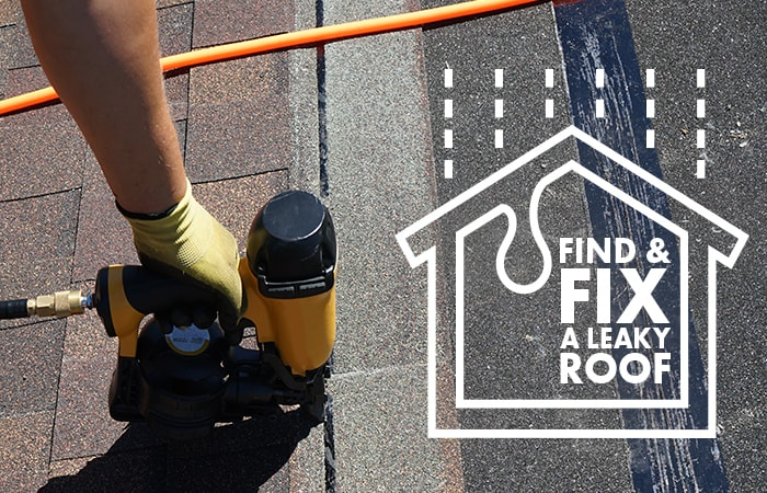 Photo of a hand of a man using a nail gun to fix a roof