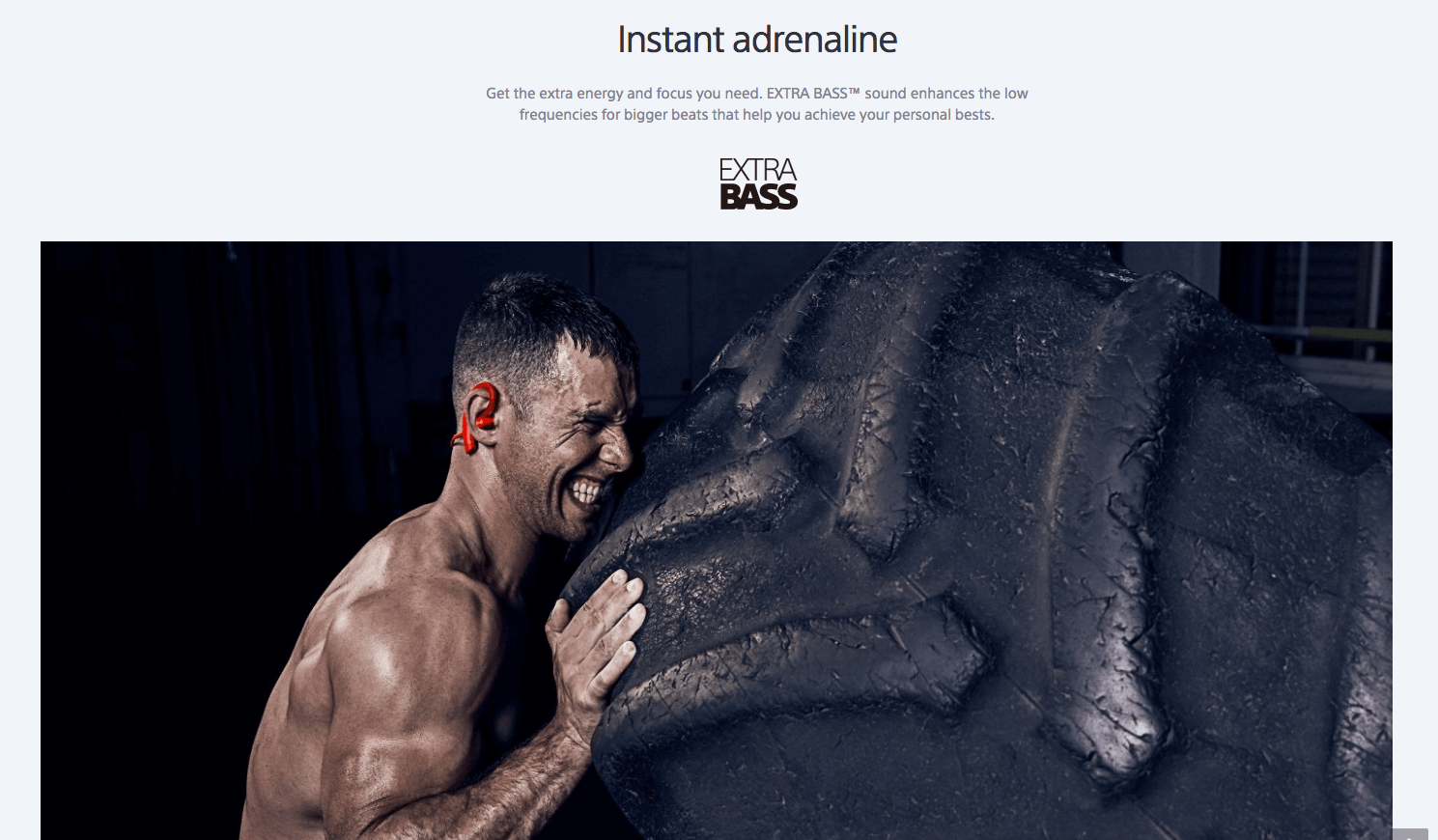 Extra Bass headphones web page with man pushing tyre