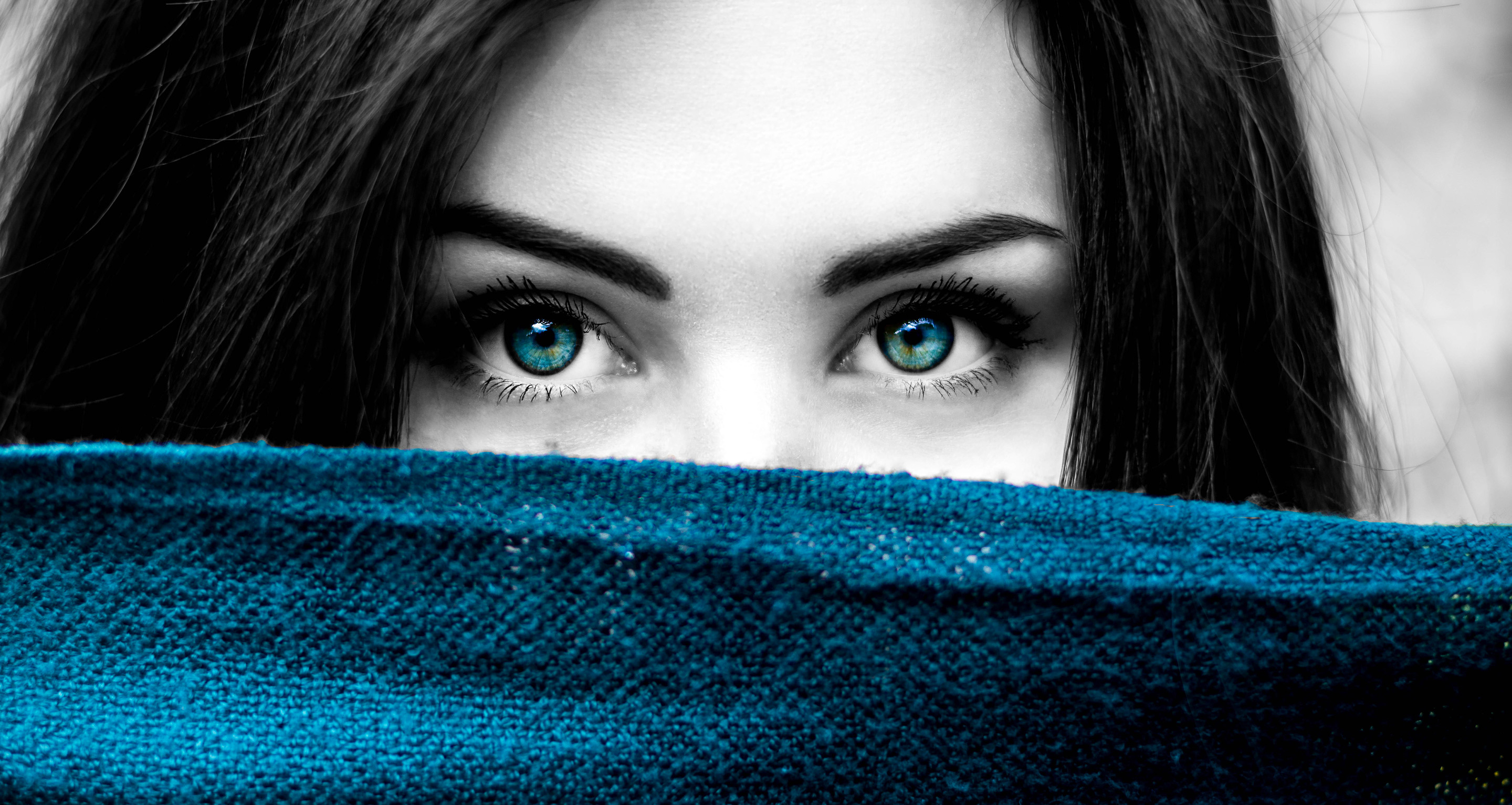 Close-Up Photo of Woman With Blue-Green Eyes