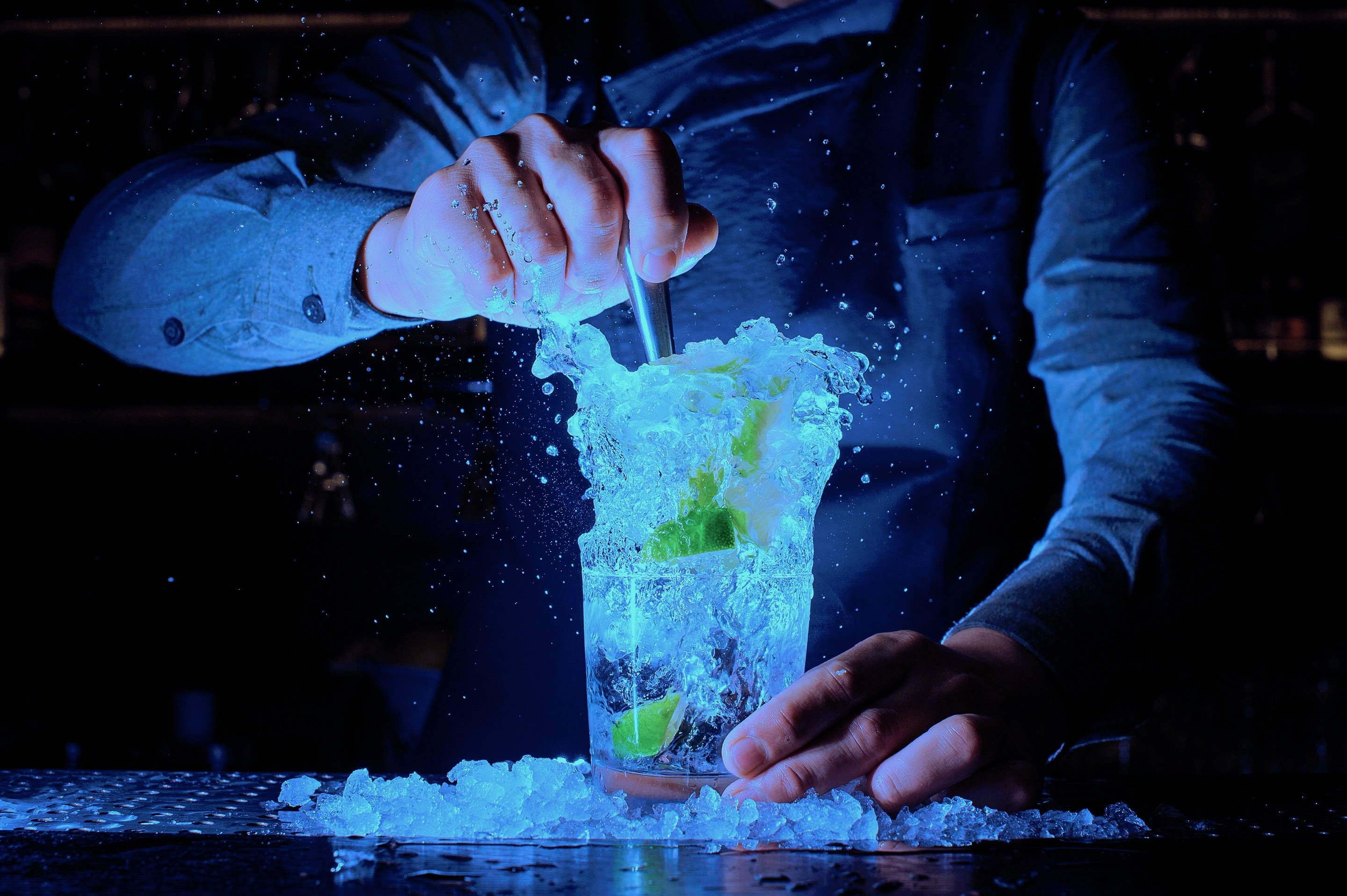 Photo of A Cocktail Splashing Out Of A Glass