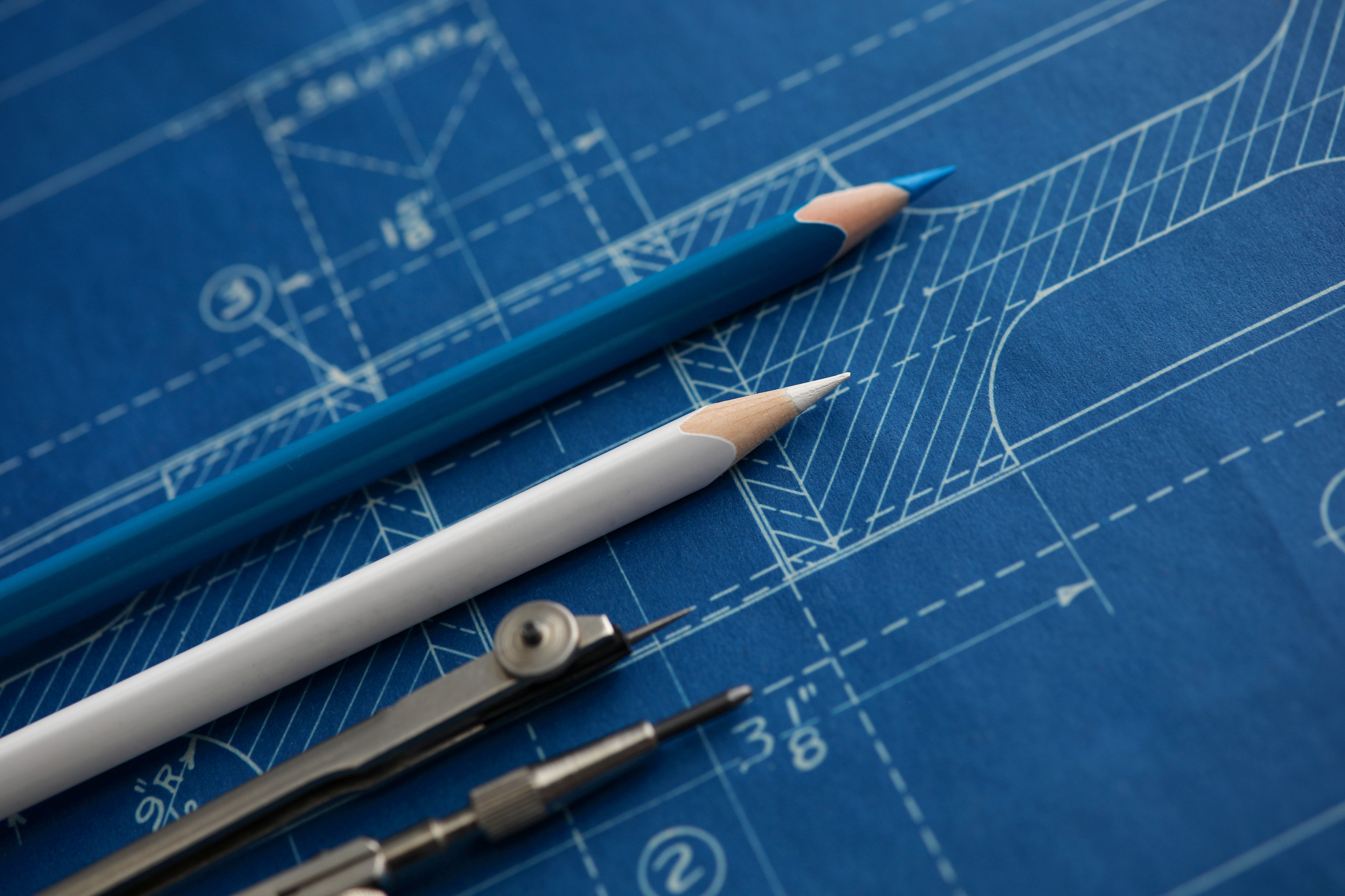 Drafting tools lying on top of a blueprint.
