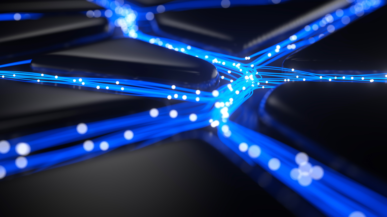 Data streaming through blue fiber optic cable.