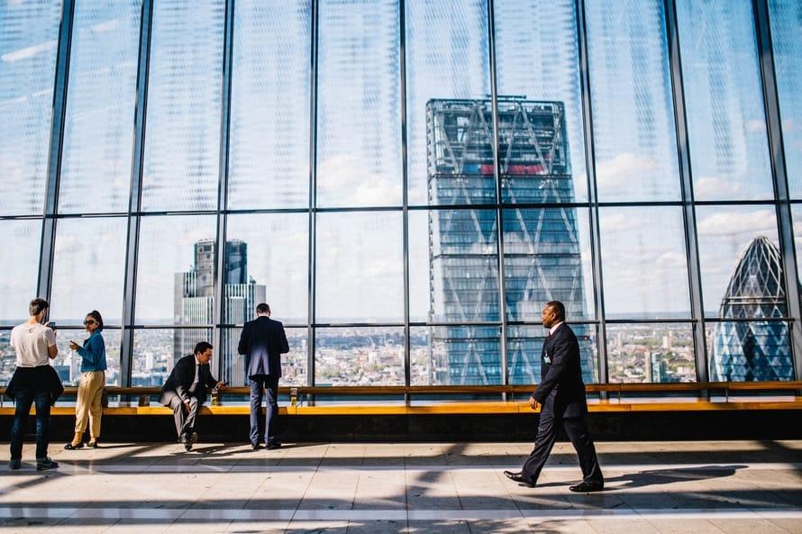 businessman walking by window