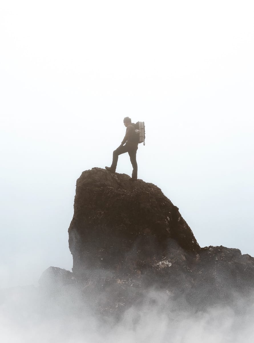 man on top of a mountain