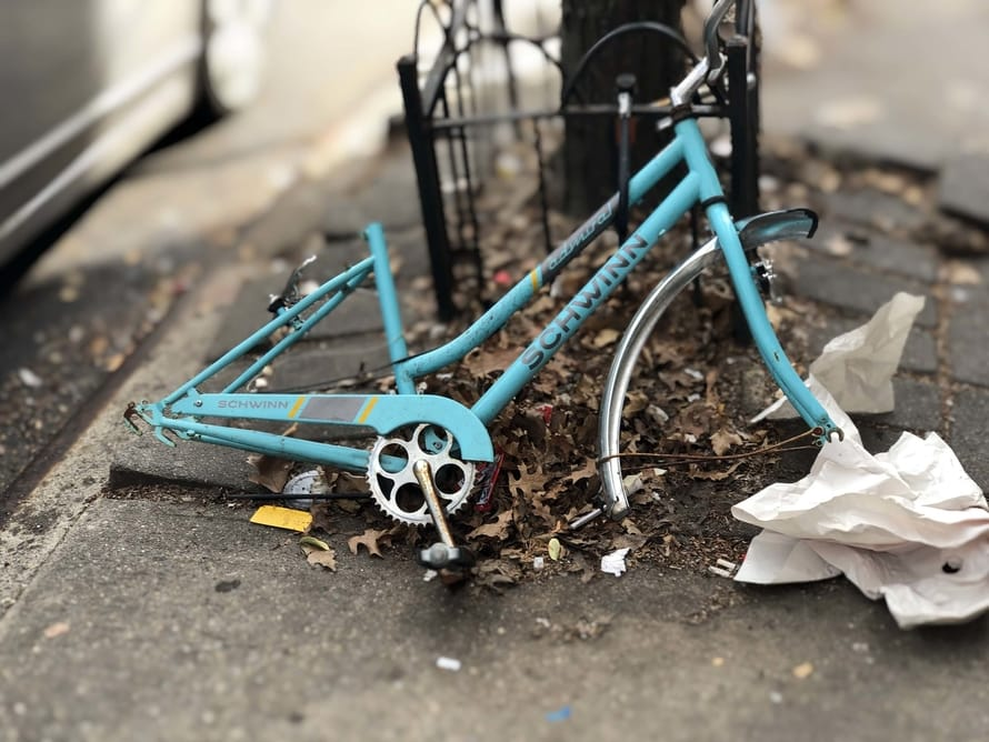 broken bike without wheels