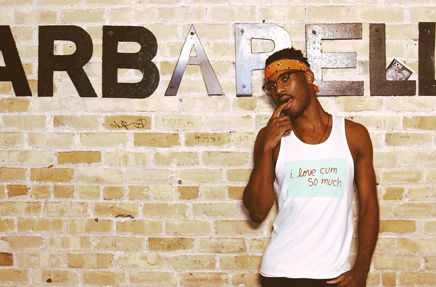Young black man wearing queer tank top