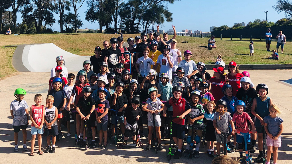 An photograph of kids and the Elanation team at a skate park, after filming a new promo video.