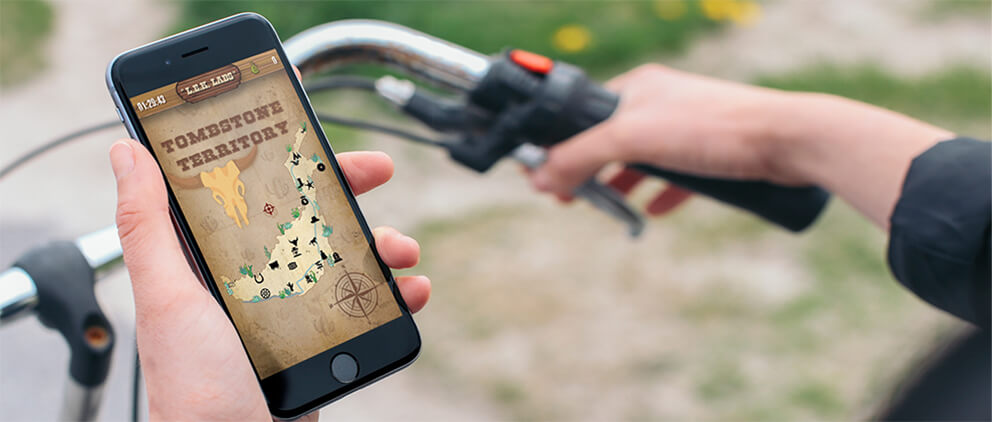 An image of someone playing the LEK Labs Wild West Adventure while on their bike