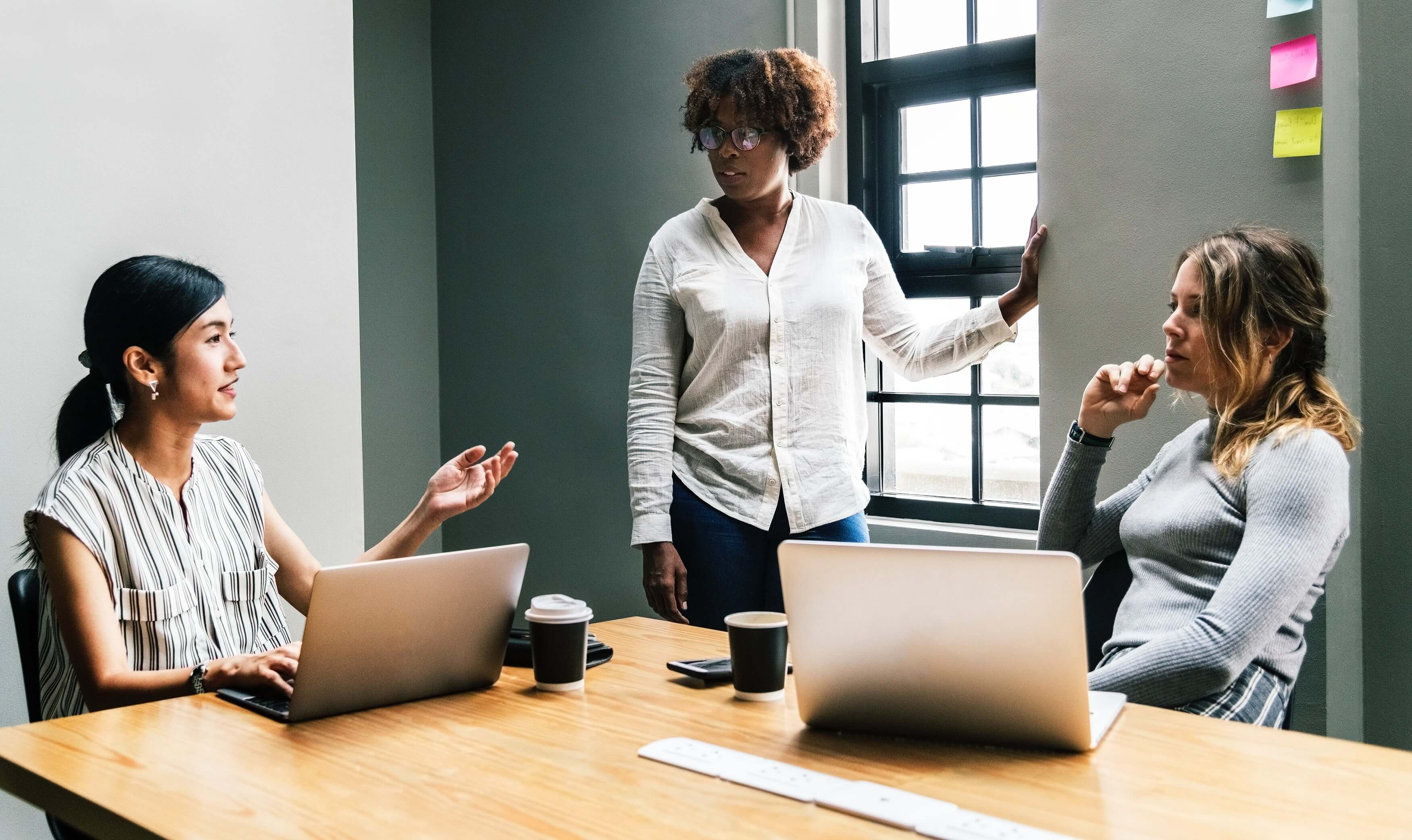 An image of 3 women having a workshop meeting