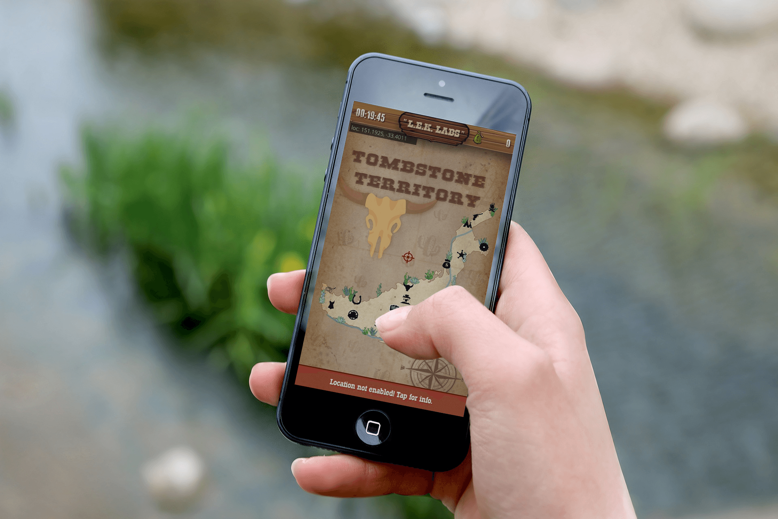 An image of someones hand who is playing LEK Labs Wild West Adventure app