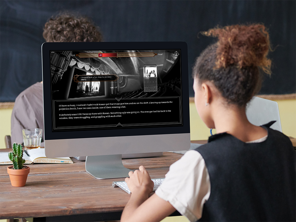 An image of a student playing The Great Fire on an iMac. The Great Fire is available on Windows and MacOS
