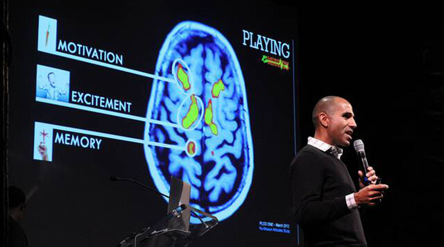 A photograph of a man presenting a study of the brain.  - Chaos Theory | Serious Games Developer, Australia