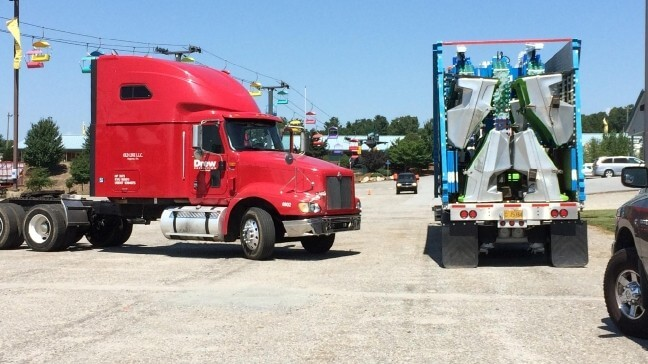 A photograph of two semi-trailer trucks   Chaos Theory Games: Battle Toyale Case Study