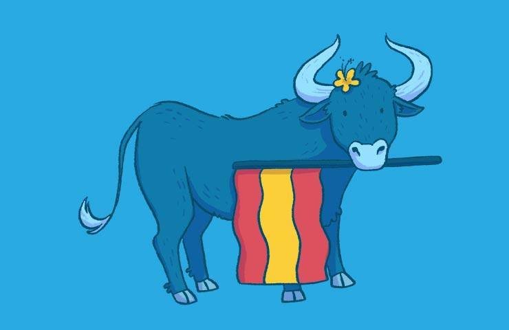ein Stier mit einer spanischen Flagge.