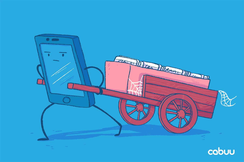 Ein Smartphone schiebt einen eingestaubten Vokabelkasten.