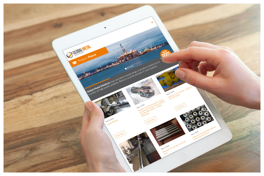 Photo of an iPad with Global Metal Solutions website on, designed by Connect Creative Design