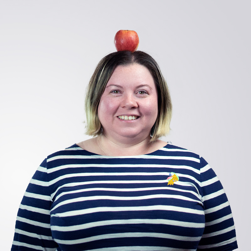 Courtney with an apple on her head