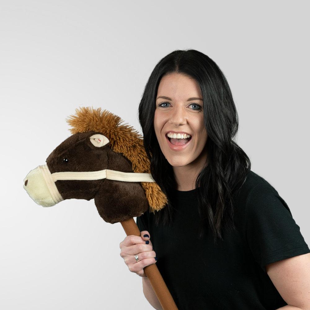Aubrey riding a fake horse