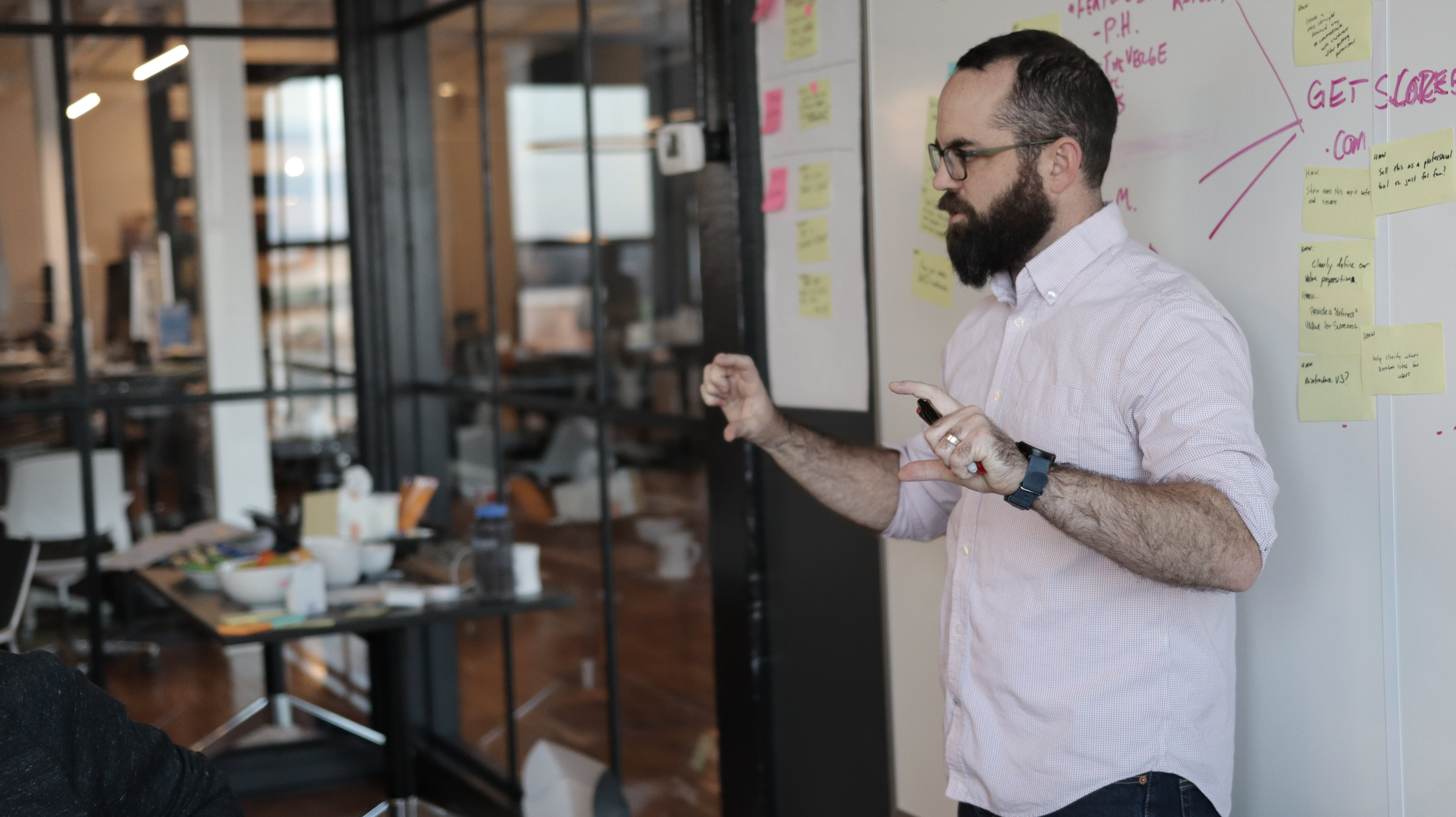 strategist in design spring showing how something works in front of room