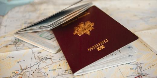 Two red UK pre-brexit passports on a table
