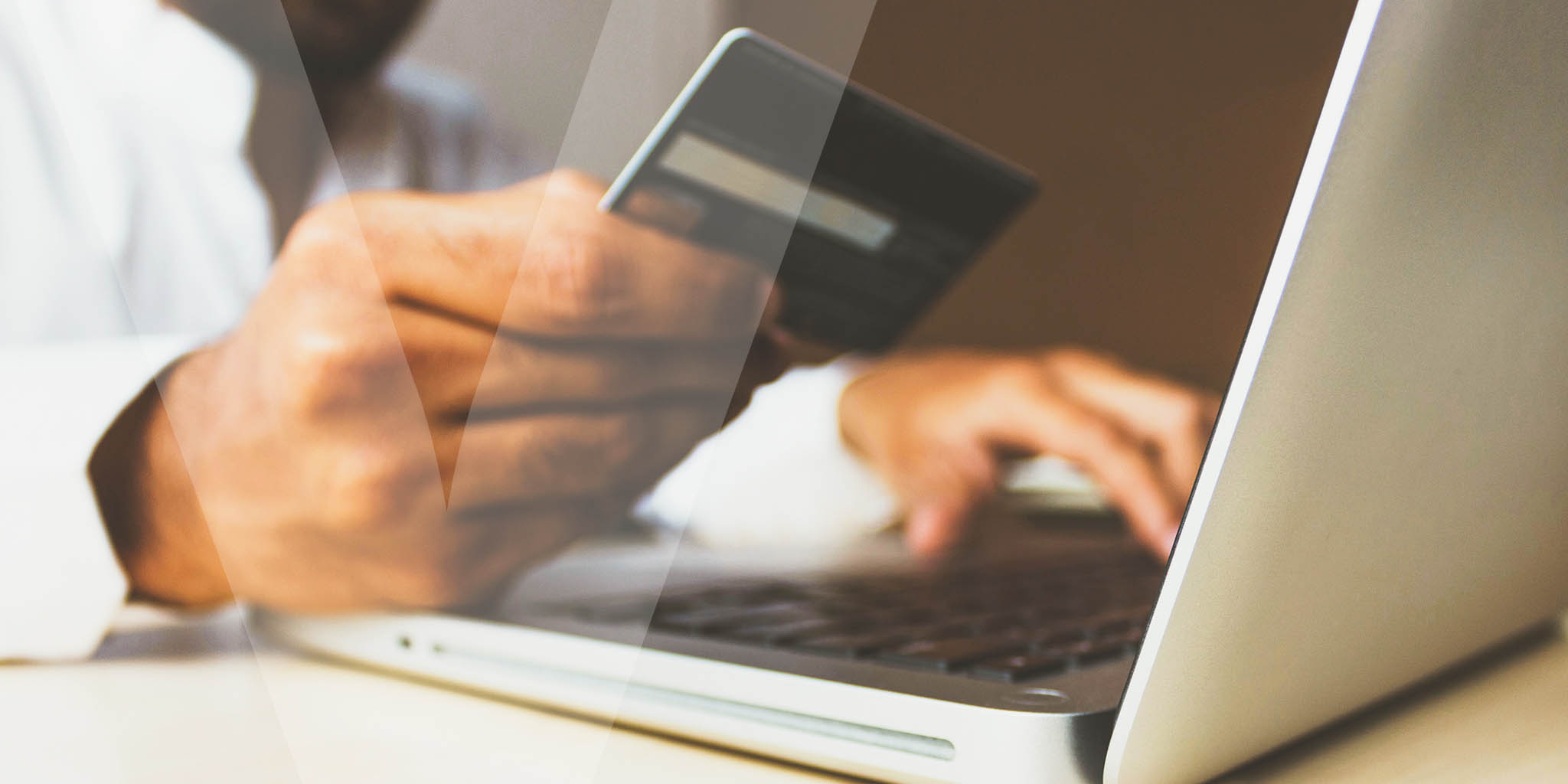 A person using their credit card to pay online