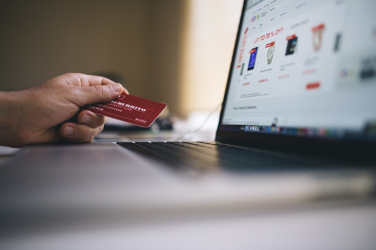 A person using their card while looking for things to buy online