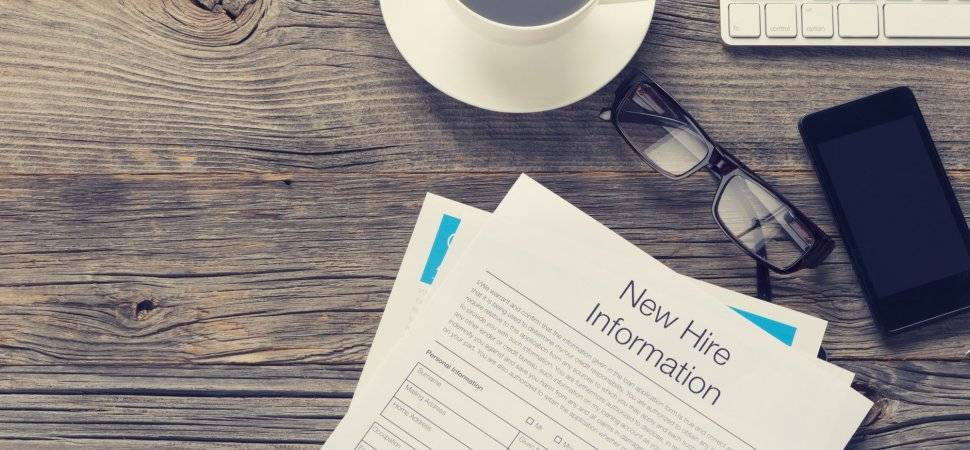 New hire onboarding documents on a table