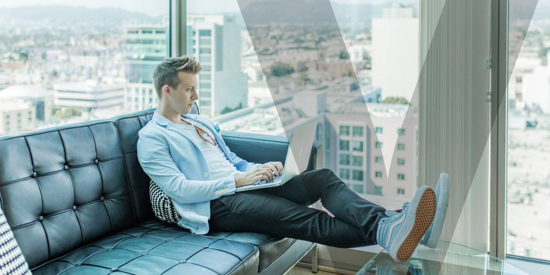 A person sitting on a couch and working from home