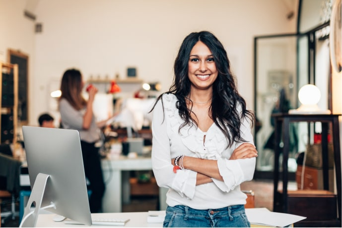 A smiling woman employee in an office environment