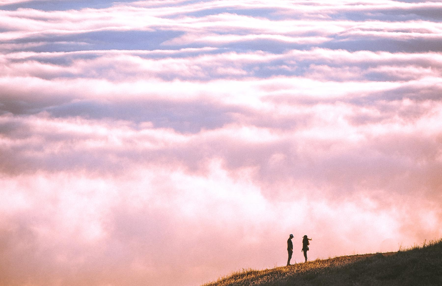 Picture of a couple in front of clouds
