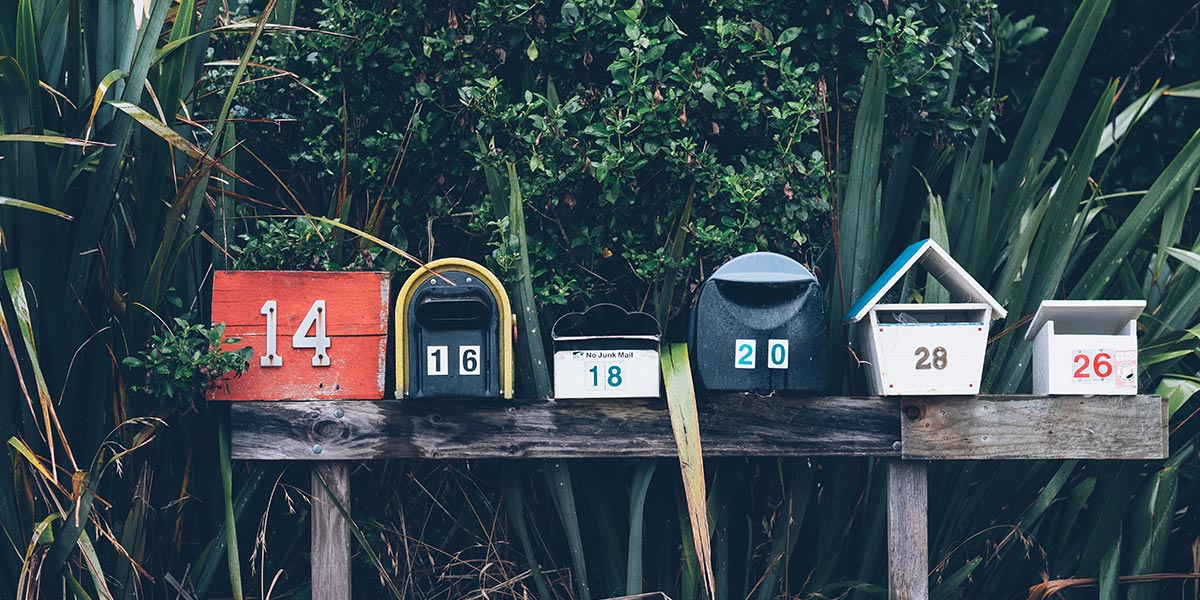 An assorted group of American style, numbered mail boxes