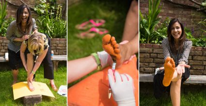 Julia Bradbury having her foot painted Orange for the photo of her placing a footprint down for the Ad campaign