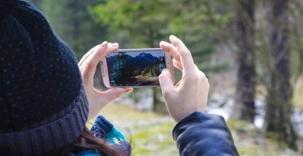 A person using a phone to take pictures