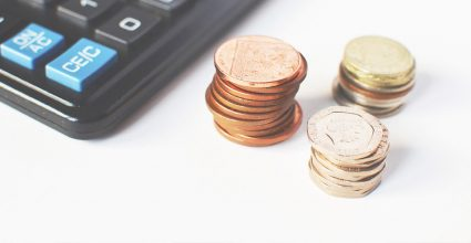 Stacks of diierent coins on a desk