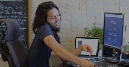 One of our founders taking a call at his desk