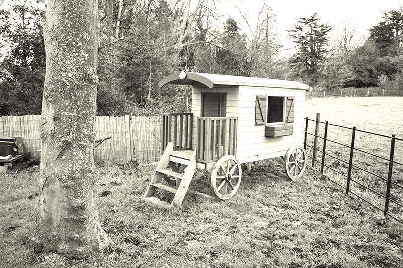 Old fashioned Gypsy caravan in the garden